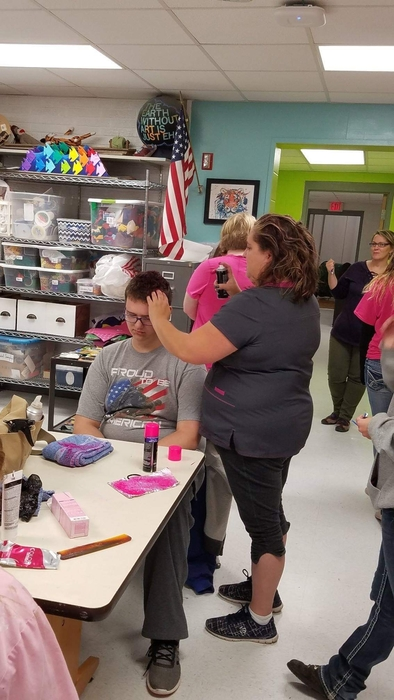 "Boutique Family Hair Care volunteers ""pinking out"""