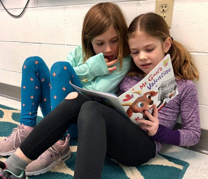 First grade friends love reading during indoor recess