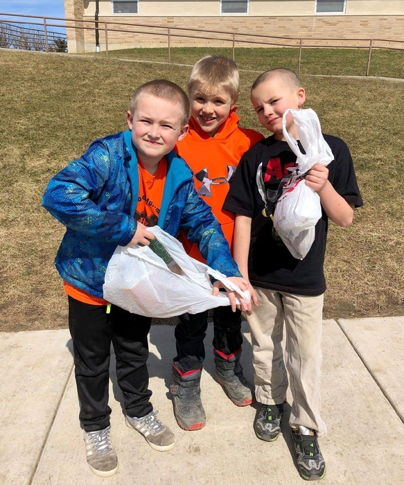 2nd Grade boys helping clean up