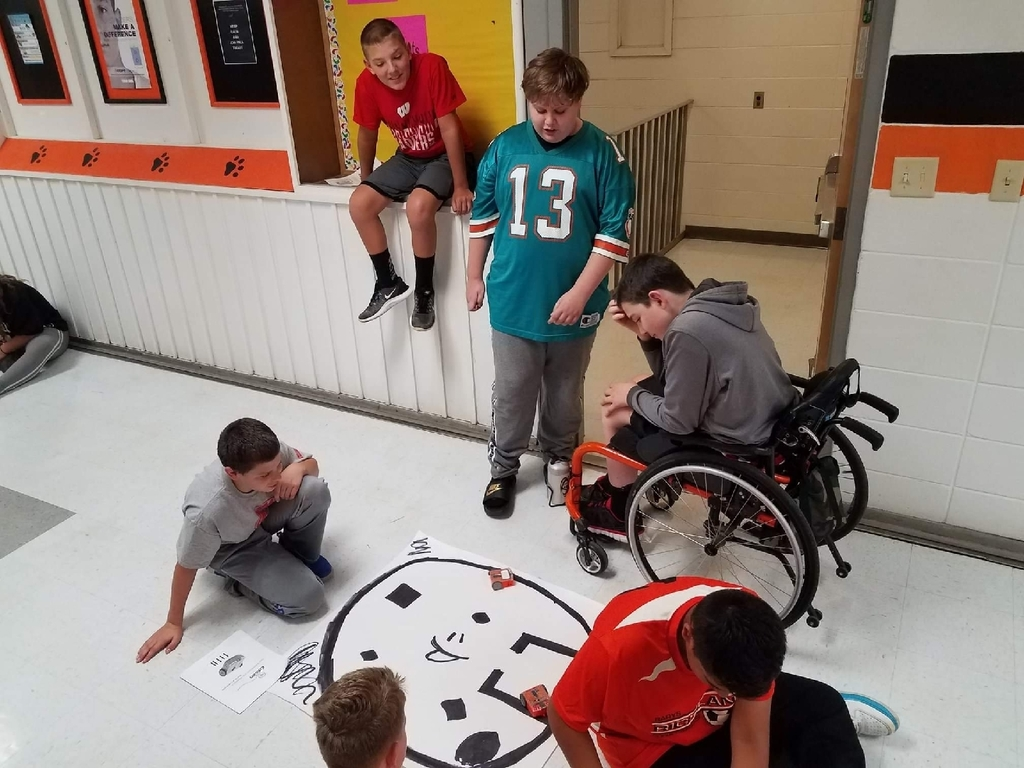 Eighth Grade Computer Science students programmed Edison robots this week