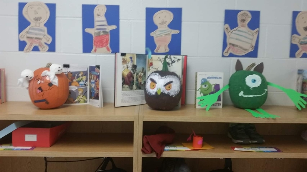 First graders read a story then transformed a pumpkin into a character from the story