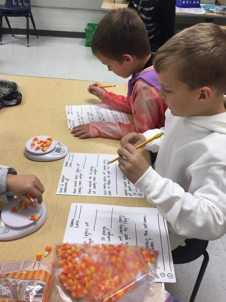 Third graders took time on Halloween to practice measuring by grams and kilograms