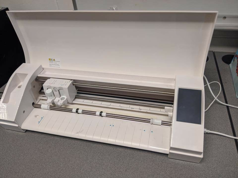 Silhoutte electronic cutting tool and a Glowforge 3-D Laser Printer in the Makerspace