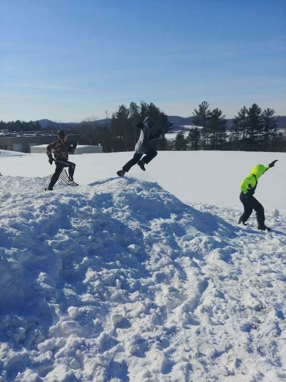 These fifth graders are certainly enjoying this new snow pile